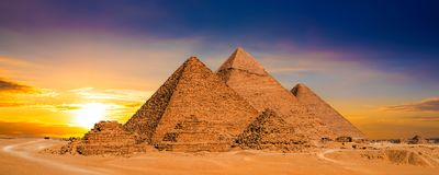 Sunset in egypt. Great Pyramids of Giza, Egypt, at sunset royalty free stock photography