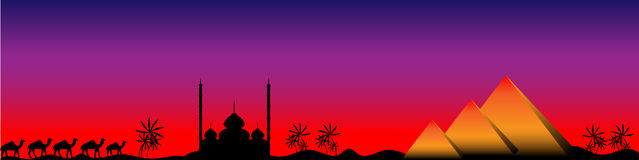 Sunset in Egypt, panorama. Sunset in Egypt with mosque, pyramids and camels, panorama Royalty Free Stock Photo