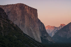 Sunset at el capitan and half dome from tunnel view Royalty Free Stock Image