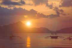 Sunset at El Nido. Banca boat anchored in a bay. Palawan island, Philippines Stock Photos