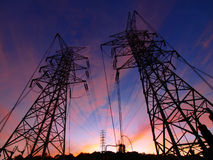Sunset and electric towers Stock Images