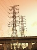 Sunset and electric towers Stock Photography