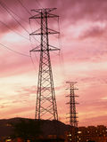 Sunset and electric towers Stock Photos