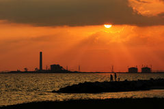 Sunset at electrical plant Stock Image