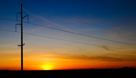 Sunset and electricity pole Stock Images