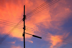 Sunset and electricity pole. Sunset in Thailand and electricity pole Stock Image