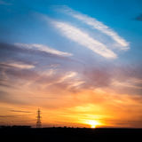 Sunset and electricity pylon Royalty Free Stock Image
