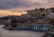 Sunset on the embankment of Valletta. Malta. Maltese style. Sunset in Valletta Stock Images