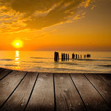 Sunset and empty wooden deck table. Stock Images