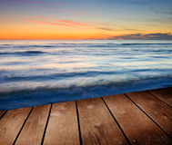 Sunset and empty wooden deck table. Royalty Free Stock Image