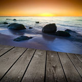 Sunset and empty wooden deck table. Stock Photo