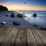 Sunset and empty wooden deck table. Royalty Free Stock Images