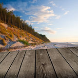 Sunset and empty wooden deck table. Stock Photography