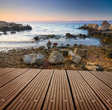 Sunset and empty wooden deck table. Royalty Free Stock Photography