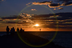 Sunset encircled. This is a photo of a crowd watching the sunset from a Gulf of Mexico jetty Stock Images