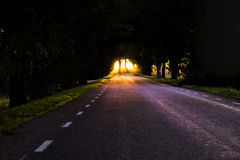 Sunset at the end of alley. Light at the end of tunnel Stock Images