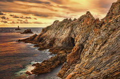Sunset at the End of the World. Beuatiful sunset on the Pointe du Raz located on Finistere coast in Brittany, north-west of France.This is the Frances most Stock Photos