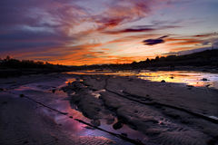 Sunset in an estuary Stock Photography