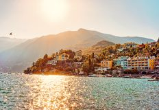 Sunset in evening in Ascona luxury tourist resort promenade. Sunset in the evening in Ascona luxury tourist resort promenade on Lake Maggiore in Ticino canton in stock image