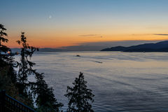 Sunset and evening of the beautiful town on Pacific Ocean in Vancouver, Canada. Tranquil sunset and evening illuminations of the beautiful town of Nanaimo on Stock Images