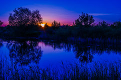 Sunset on the evening lake Royalty Free Stock Photography
