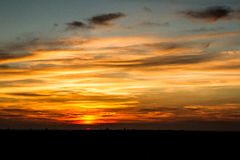 Sunset. A evening landscape with beautiful clouds image Stock Photos