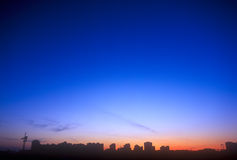 Sunset. Evening over a city. Useful as background for your projects Stock Photos