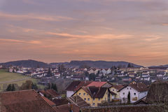 Sunset and evening-red in the Bavarian forest with view of the city Grafenau Royalty Free Stock Photography