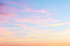 Sunset in the evening sky. Pink clouds against the blue evening sky Royalty Free Stock Photos
