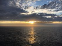 Sunset. Evening sun cloudy rain Stock Photo