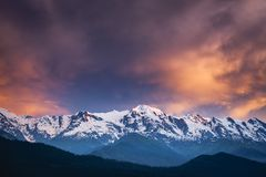 Sunset evening view over the snowy mountain range Stock Photography