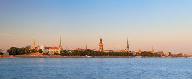 Sunset evening view of Riga cityline panorama over river Daugava with all landmarks of old town. stock image