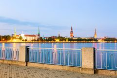 Sunset evening view of Riga cityline panorama over river Daugava with all landmarks of old town. View from Daugava quay. stock photos