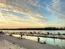 Sunset evening in Zemun with fishermen Stock Photography