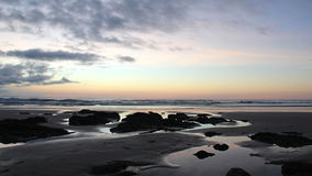 Sunset on a exotic isolated beach in costa rica, volcanic rocks and beach. Sunset beach, isolated beach in central america, beautiful beach and sunrise, blue sky Stock Photography