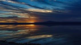 Sunset falling over Atacama salar and Chaxa lagoon reflection