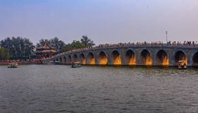 Sunset at the famous 17 arch lion bridge on Kunming Lake by Summer Palace in Beijing China royalty free stock images