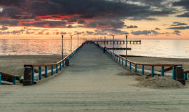 Sunset at a famous pier in Palanga, Lithuania Stock Images