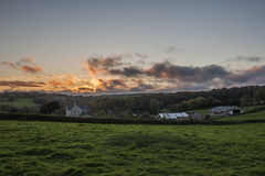 Sunset in farm fields with beautiful cloudy sky, Cornwall, UK Royalty Free Stock Photo