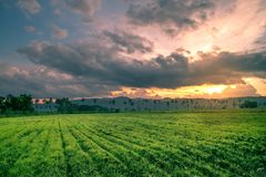 Sunset with farm in foreground stock photos