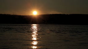 Sunset fascinating phenomena of nature observe in summer open spaces. Sunset fascinating phenomena of nature observe in summer in open spaces on river, horizon stock footage