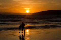 Sunset father and son Royalty Free Stock Images