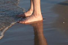 Sunset feet. A pair of feet at beach Royalty Free Stock Images