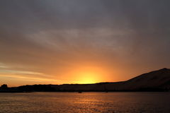 Sunset with feluccas on the Nile in Egypt Stock Photo