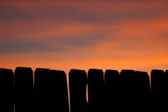 Sunset Fence. A high-contrast wooden fence outlined in a Texas sunset Stock Photography