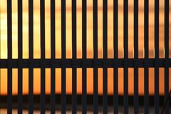 Sunset fence. Sunset view from behind a fence Royalty Free Stock Photos