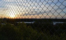 Sunset Through the Fence. Sunset with Philadelphia in the distance Stock Image