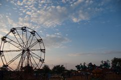 Sunset Ferris Wheel ride in Bulawayo in Zimbabwe. Lot of family fun stock photos