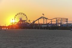 Sunset at the ferris wheel, Santa Monica Pier, Los Angeles Royalty Free Stock Images