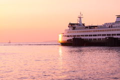 Sunset ferry. A washington state ferry awaits final boarding before setting off on a sunset cruise Stock Photos